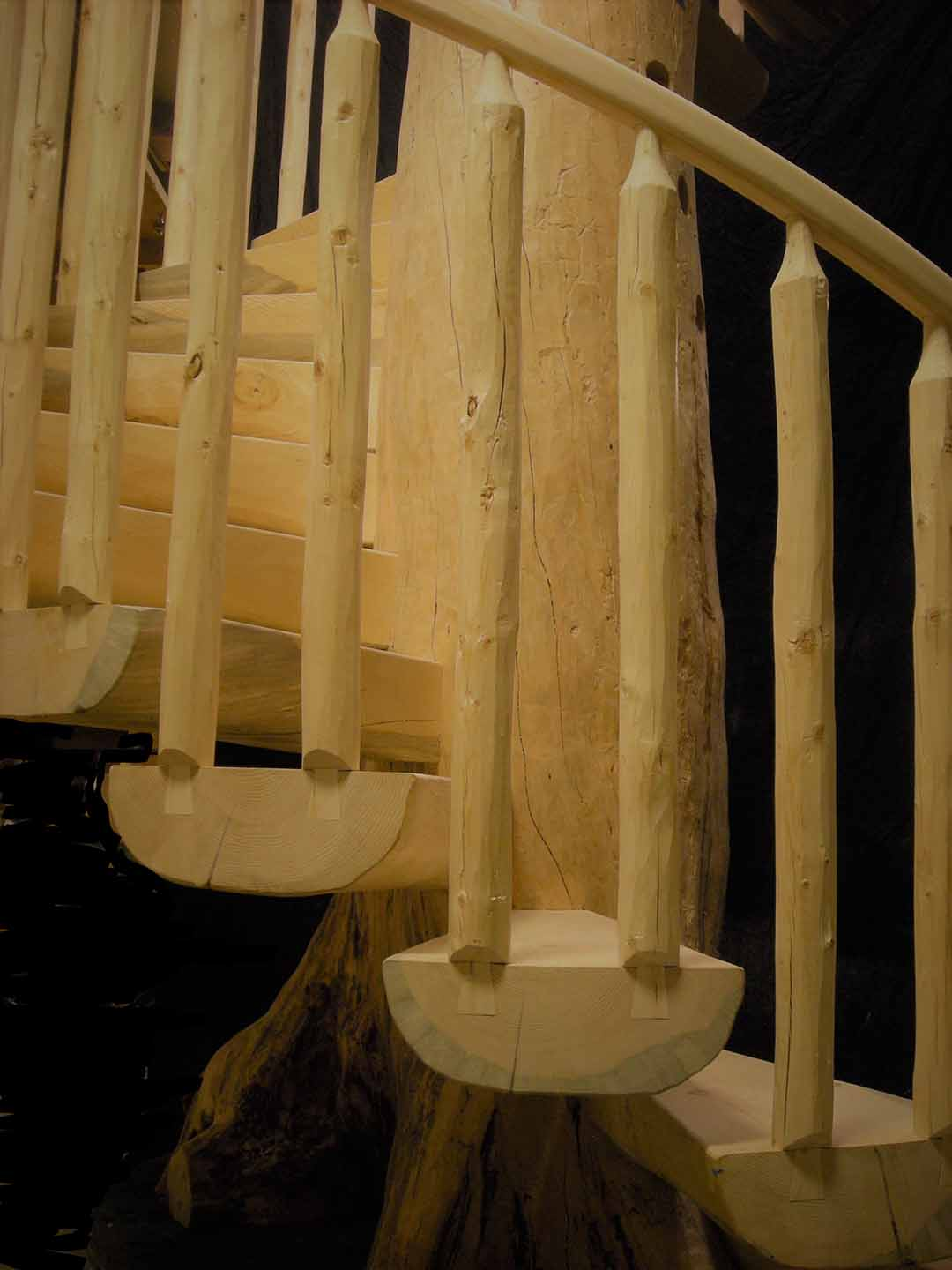 Custom Log Spiral Stairs with Dovetail Railing