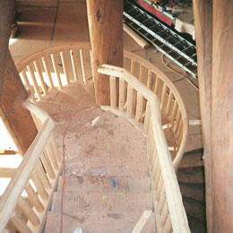 Custom Log Spiral Stairs and Railing